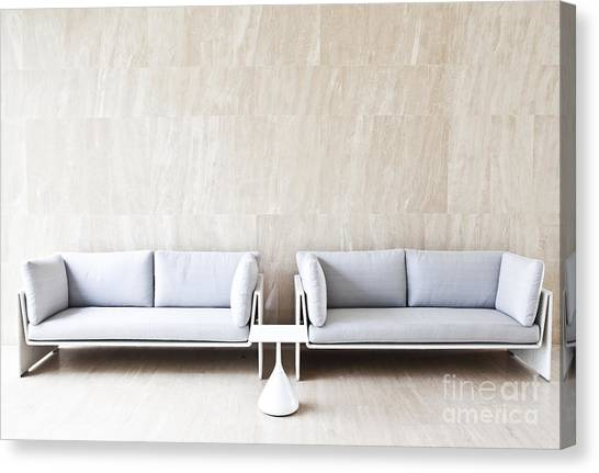2 Sofas Canvas Print by Chavalit Kamolthamanon