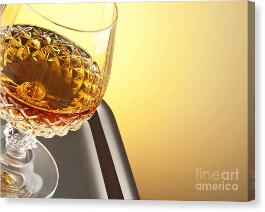 Rum Canvas Print - Whiskey In Stem Glass by Blink Images