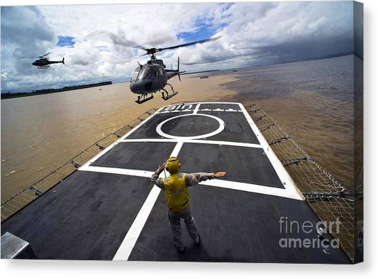 Amazon River Canvas Print - A Brazilian Eurocopter Prepares To Land by Stocktrek Images