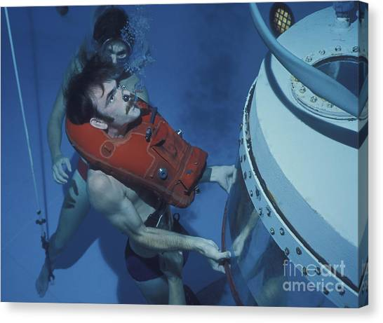 Diving Bell Canvas Print - A Buoyant Ascent Training Student Holds by Michael Wood