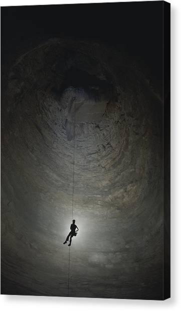 Spelunking Canvas Print - A Caver Rappels 510 Feet Into Ellisons by Michael Nichols