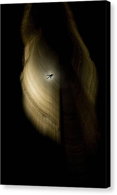 Spelunking Canvas Print - A Caver Rappels The Drop Of The Deepest by Stephen Alvarez
