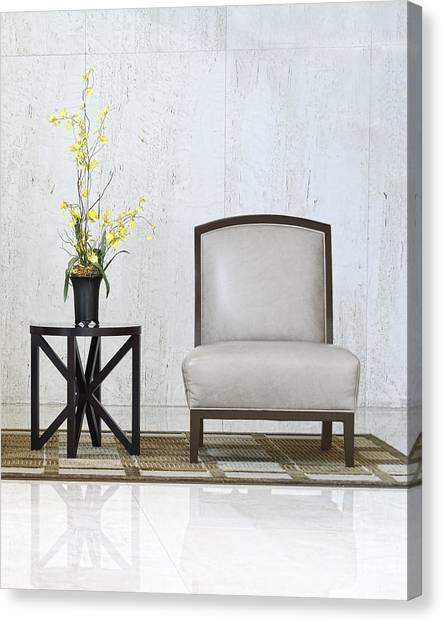 A Chair And A Table With A Plant  Canvas Print