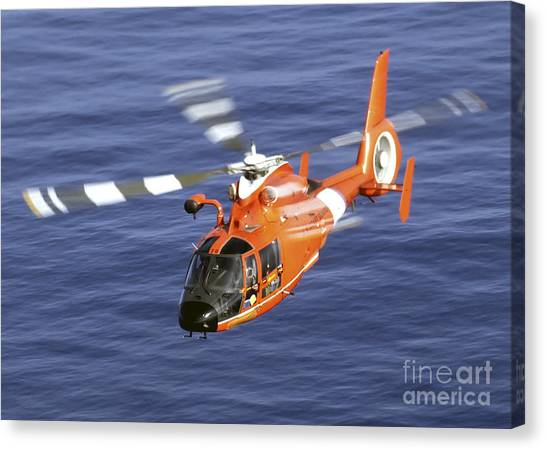 Medivac Canvas Print - A Coast Guard Hh-65a Dolphin Rescue by Stocktrek Images