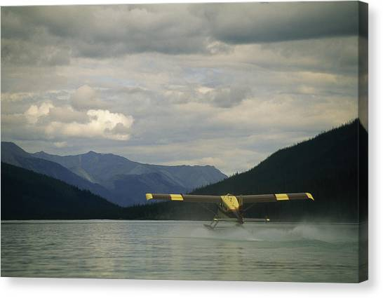 Canada Glacier Canvas Print - A Float Plane Takes Off From Glacier by Gordon Wiltsie