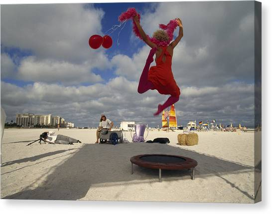 Trampoline Canvas Print - A High-spirited Model Poses by Annie Griffiths