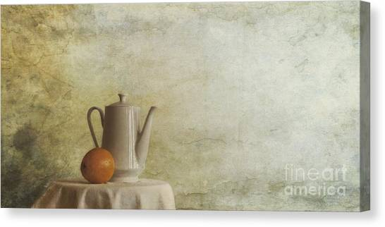 Amber Canvas Print - A Jugful Tea And A Orange by Priska Wettstein