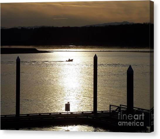 A Lone Boat At Sunset Canvas Print