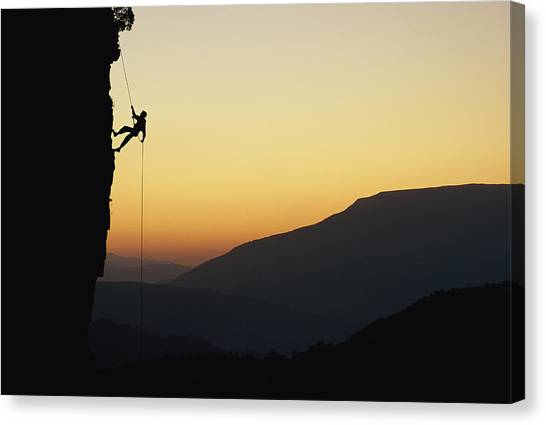 Republic Of South Africa Canvas Print - A Man Rappels Down A Cliff by Bill Hatcher