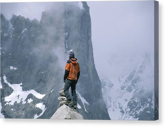 Karakoram Canvas Print - A Man Stands On A Cliff Watching by Jimmy Chin