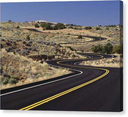 Road Canvas Print - A Newly Paved Winding Road Up A Slight by Greg Probst
