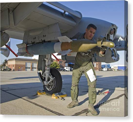 Warheads Canvas Print - A Pilot Inspects A Gbu-12 Laser Guided by HIGH-G Productions