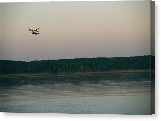 Northwest Territories Canvas Print - A Seaplane Soars Above The Mackenzie by Raymond Gehman