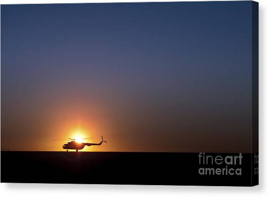Sunrise Horizon Canvas Print - A Sikorsky S-61l Mk II Helicopter Taxis by Stocktrek Images