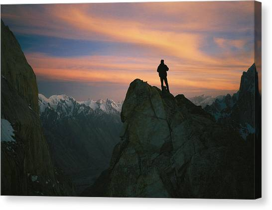 Trango Towers Canvas Print - A Silhouetted Climber Watches The Sun by Bobby Model