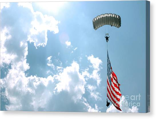 Green Berets Canvas Print - A Skydiver Carries A U.s. Flag While by Stocktrek Images