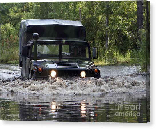 Truck Driver Canvas Print - A Soldier Drives A Humvee by Stocktrek Images