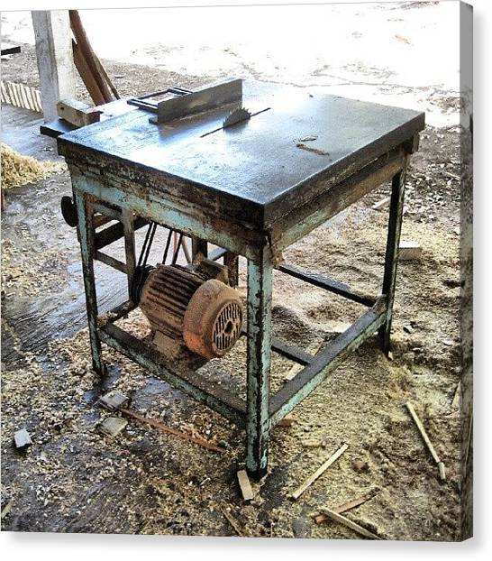 Factories Canvas Print - A Trusty And Well Worn Table Saw In A by Reid Nelson