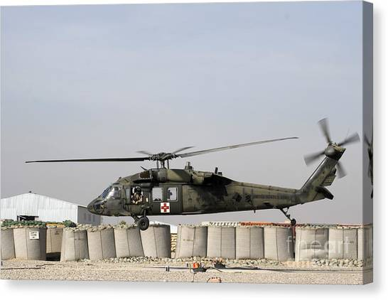 Medivac Canvas Print - A Uh-60 Blackhawk Prepares To Land by Terry Moore