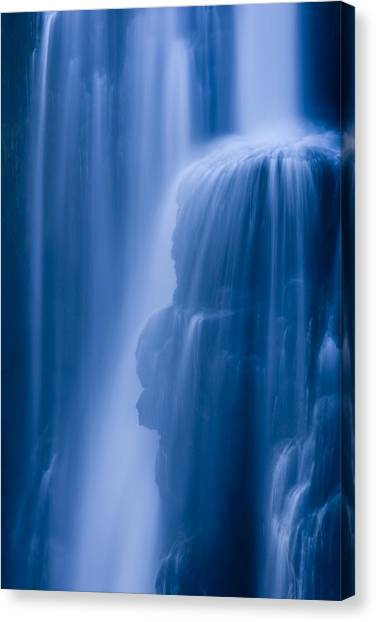 Water Canvas Print - A Waterfall Splashes Off Of A Large by Ralph Lee Hopkins