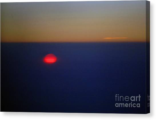 Above The Sunset Canvas Print by Gib Martinez