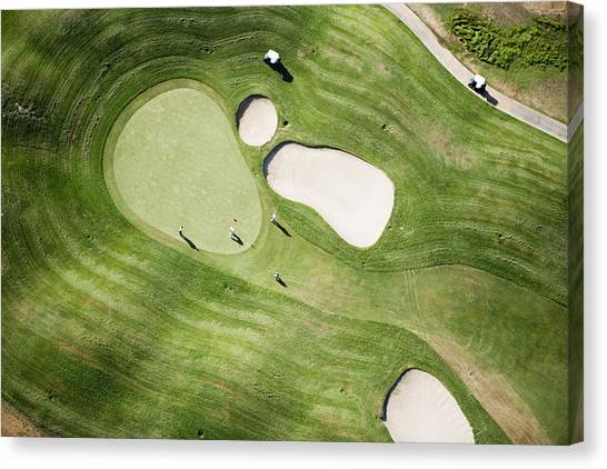 Aerial Of Golfers On Green Of Tierra Del Sol Golf Course Canvas Print by Holger Leue
