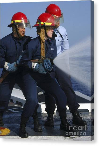 Air Traffic Control Canvas Print - Airmen Participate In A Fire Hose Team by Stocktrek Images