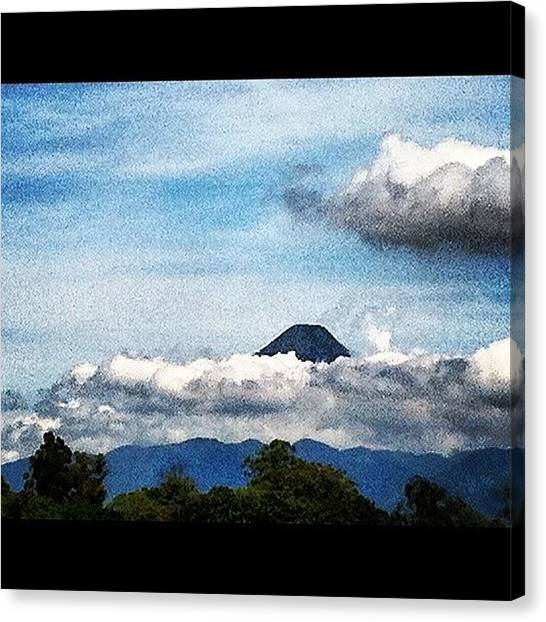 Volcanoes Canvas Print - #airplane #clouds #flying #guatemala by Artistic Shutter