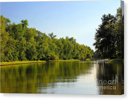 Along The Canal Canvas Print by Sophie Vigneault