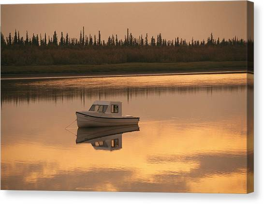 Northwest Territories Canvas Print - An Anchored Boat Floats by Raymond Gehman