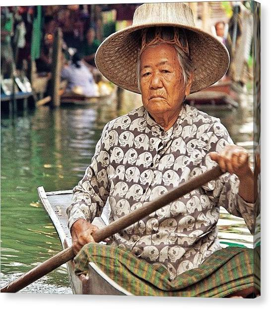 Famous Artists Canvas Print - An Elderly Lady Rowing Along The by Tommy Tjahjono