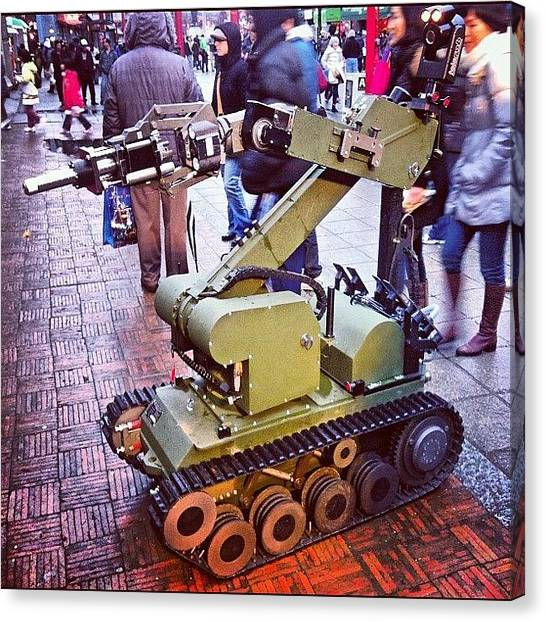 Machinery Canvas Print - An #eod #robot On #display For The by Victor Wong