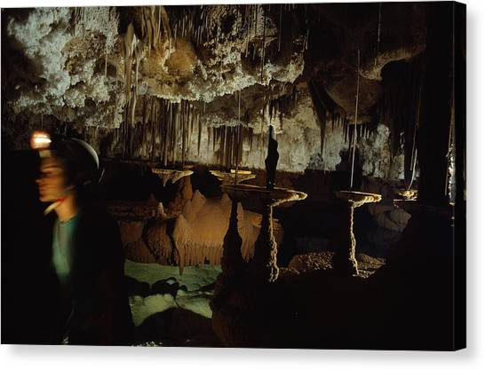 Spelunking Canvas Print - An Explorer Carefully Moves by Michael Nichols