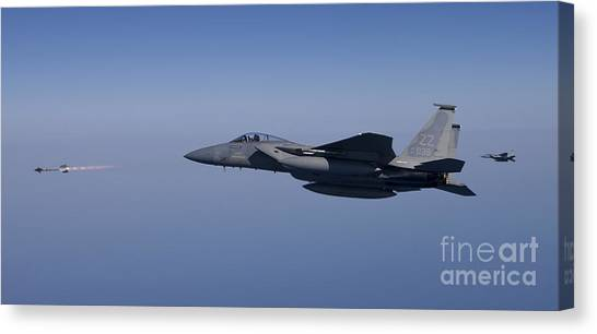 Warheads Canvas Print - An F-15 Eagle Fires An Aim-9 Missile by HIGH-G Productions
