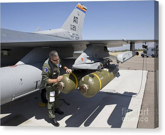 Warheads Canvas Print - An F-16 Pilot Conducts A Preflight by HIGH-G Productions