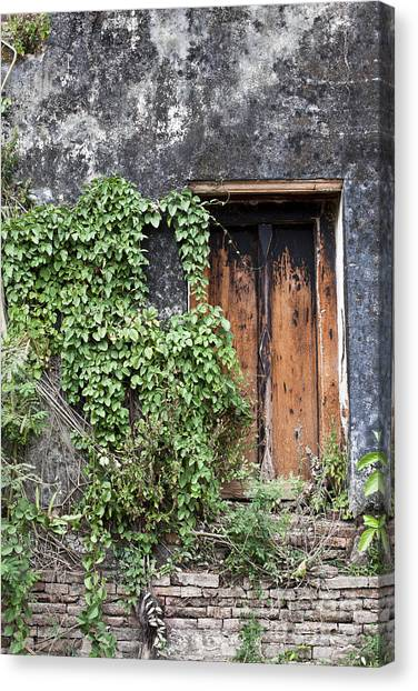 Ancient Window In Old Temple Thailand Canvas Print by Chavalit Kamolthamanon
