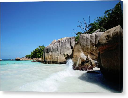 Anse Lazio Canvas Print by Dhmig Photography