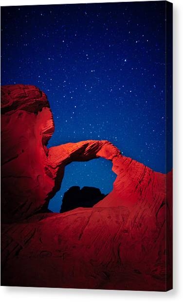 Valley Of Fire Canvas Print - Arch In Red And Blue by Rick Berk