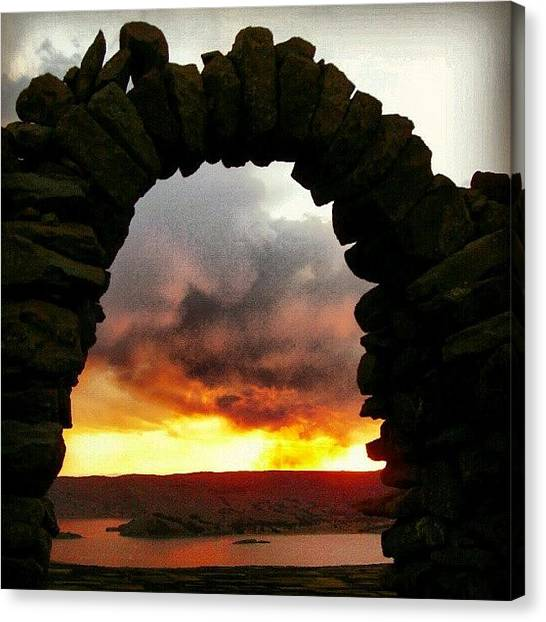 Peruvian Canvas Print - #arch Over #titicaca #lake In #peru by Yannick Menard