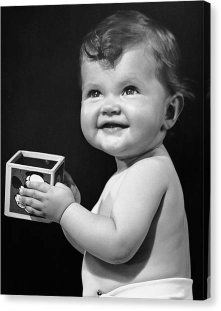 Baby Holding Block Canvas Print by George Marks