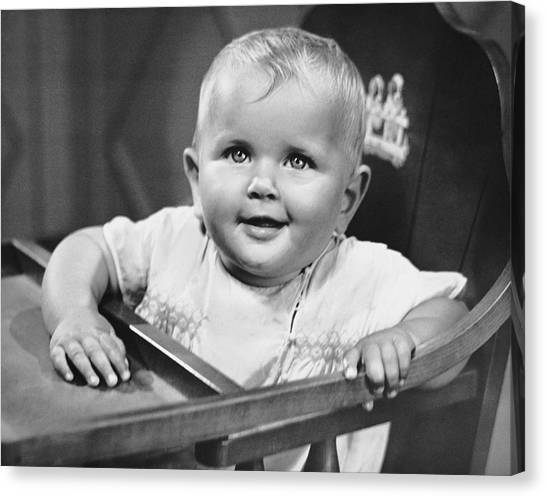 Baby In Highchair Canvas Print by George Marks