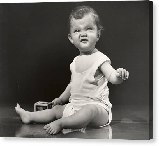 Baby Making Funny Face Canvas Print by George Marks