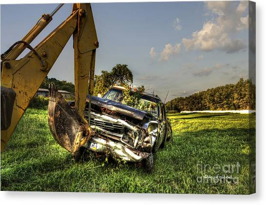 Backhoe Pulling Car Out Of Field Canvas Print by Dan Friend