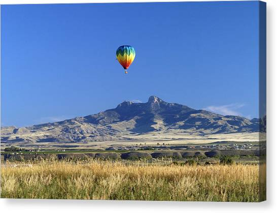 Balloon Over Heart Mountain Canvas Print by Lora Ballweber