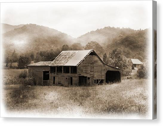 Barn In The Mist Canvas Print by Barry Jones