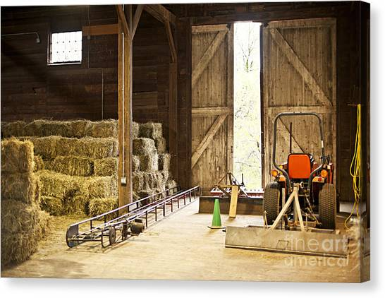 Tractors Canvas Print - Barn With Hay Bales And Farm Equipment by Elena Elisseeva