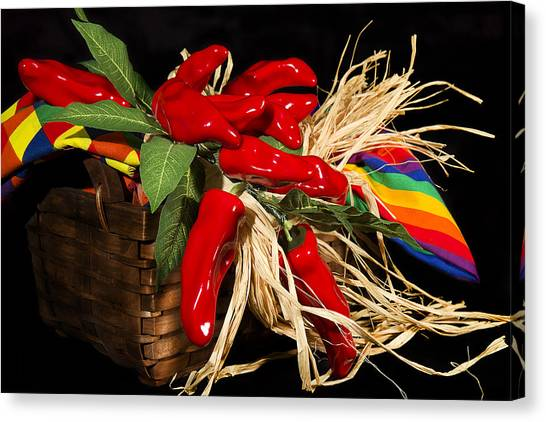 Basket Red Peppers Canvas Print by Trudy Wilkerson