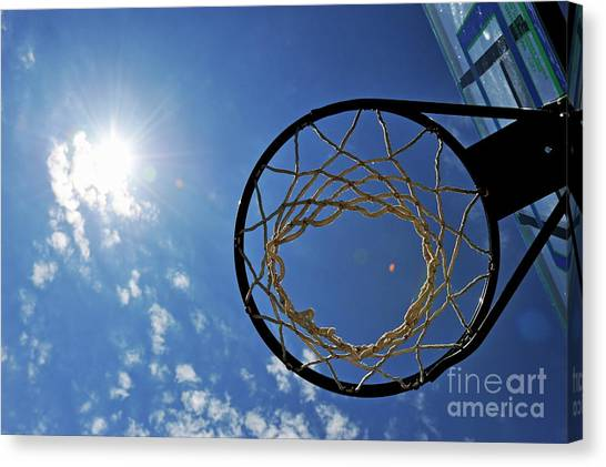 Basketball Hoop And The Sun Canvas Print by Sami Sarkis