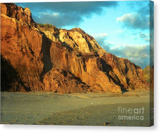 Beach Cliff At Sunset Canvas Print