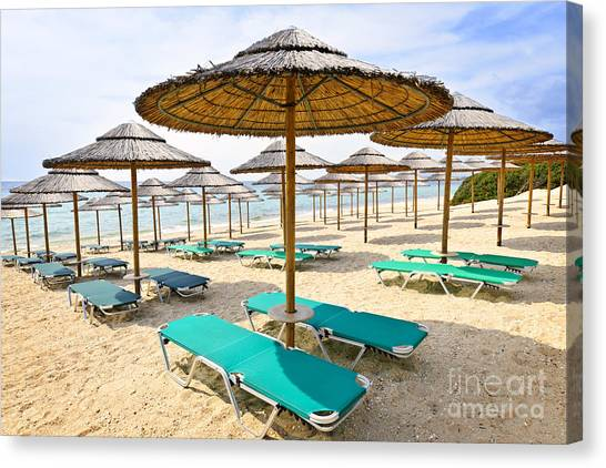 Greece Canvas Print - Beach Umbrellas On Sandy Seashore by Elena Elisseeva